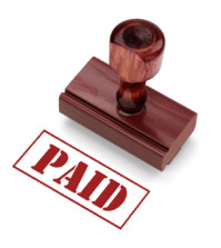 Rubber Stamp indicating payment. Includes clipping path for stamp.